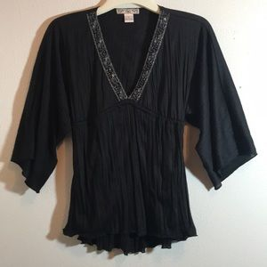 YMI blouse with plunge neck and wide sleev…